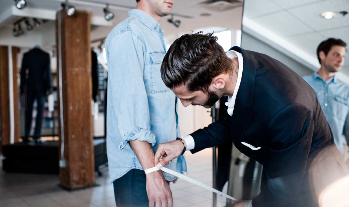 Getting measured at an Indochino Showroom