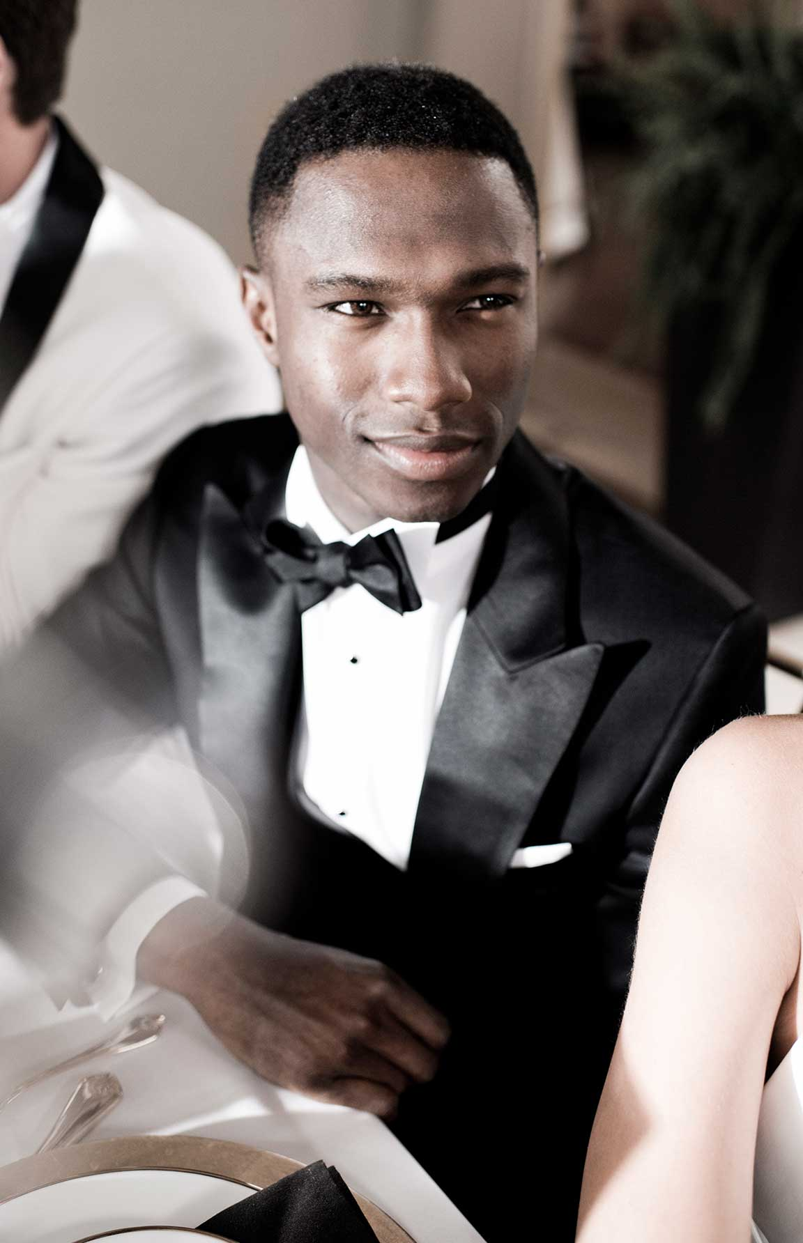 Black tie always calls for a classy black bow tie.