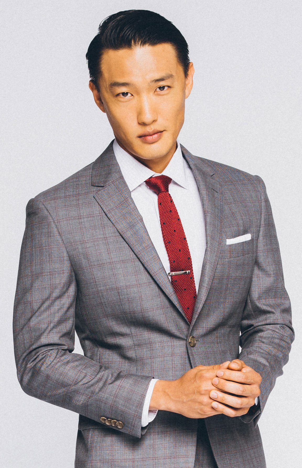 Two trends with one fit: plaid suit and knit tie.